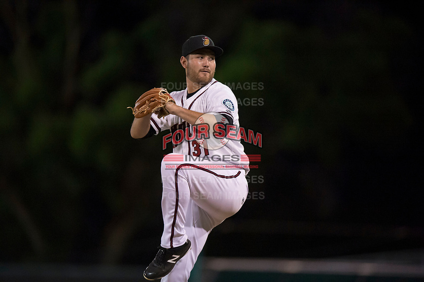 Modesto Nuts starting pitcher John Richy (31) prepares to deliver a pitch during a California League game against the Lake Elsinore Storm at John Thurman Field on May 12, 2018 in Modesto, California. Lake Elsinore defeated Modesto 4-1. (Zachary Lucy/Four Seam Images)