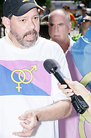 A man wearing a Straight Pride shirt is interviewed by a Vice reporter before the Straight Pride Parade in Boston, Massachusetts, on Sat., August 31, 2019. The parade was organized in reaction to LGBTQ Pride month activities by an organization called Super Happy Fun America.