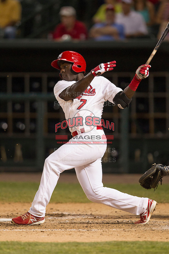Memphis Redbirds third baseman Jermaine Curtis (7) follows through on his swing against the New Orleans Zephyrs in the Pacific Coast League baseball game on June 12, 2013 at Autozone Park in Memphis, Tennessee. Memphis defeated New Orleans 9-3. (Andrew Woolley/Four Seam Images)