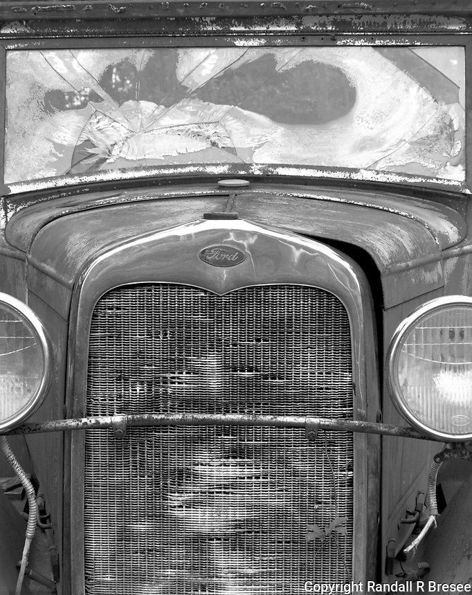 """""""Abandoned Ford""""<br /> <br /> This beautiful vehicle was begging to be photographed while resting peacefully in a pasture. The black and white photo shows textures and tones quite well."""