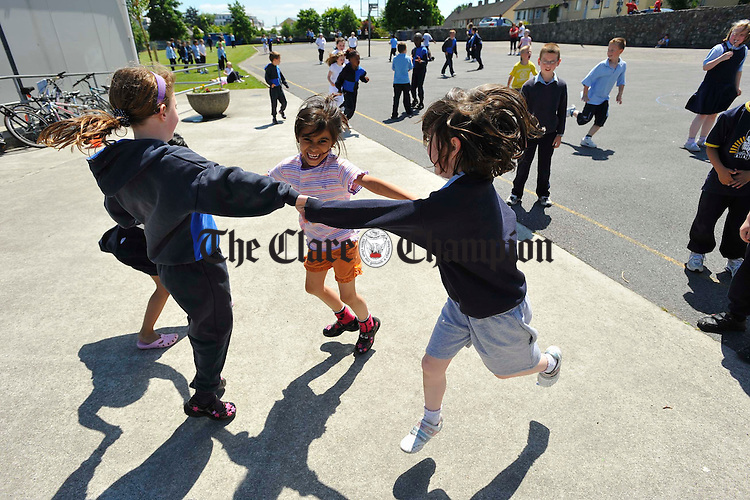 Girls playing ring a ring a rosie at Scoil Criost Ri Cloughleigh. Photograph by John Kelly.