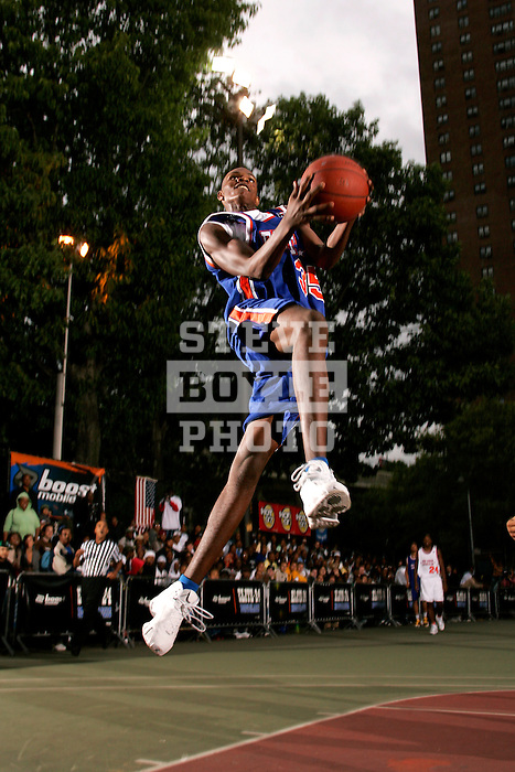 Devin Ebanks (35) goes up for a dunk during the Elite 24 Hoops Classic game on September 1, 2006 held at Rucker Park in New York, New York.  The game brought together the top 24 high school basketball players in the country regardless of class or sneaker affiliation.