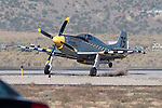 George Giboney crashes his Thunder Mustang, the Rapid Travel, during the super sport gold medal race at the 47th Annual National Championship Air Races and Air Show in Stead, Nev., on Sunday Sept. 19, 2010..(AP Photo by Kevin Clifford)
