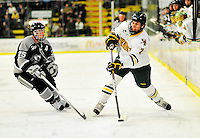 5 February 2011: University of Vermont Catamount defenseman Drew MacKenzie, a Junior from New Canaan, CT, in action against the Providence College Friars at Gutterson Fieldhouse in Burlington, Vermont. The Catamounts defeated the Friars 7-1 in the second game of their weekend series. Mandatory Credit: Ed Wolfstein Photo