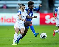 HOUSTON, TX - JANUARY 31: Melissa Herrera #7 of Costa Rica and Melchie Dumonay #6 of Haiti vie for the ball during a game between Haiti and Costa Rica at BBVA Stadium on January 31, 2020 in Houston, Texas.