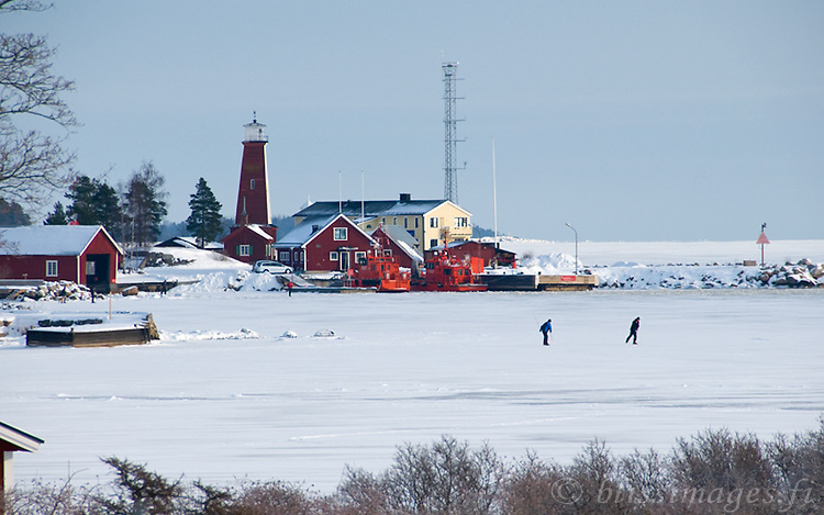 Skaters on a winter's day at Böna Lighthouse, Gävle, Sweden.