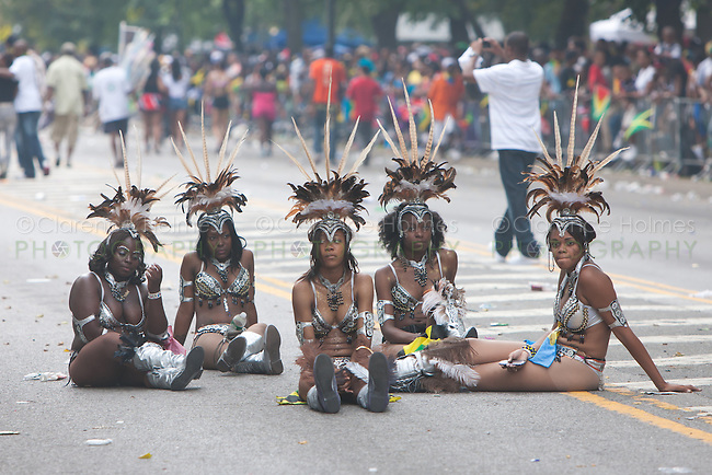 Parade participants in festive attire take a break at the West Indian American Day Parade held on Monday, September 5, 2011 in Crown Heights, Brooklyn, New York.  The annual Labor Day event, which runs along Eastern Parkway, celebrates West Indian heritage and attracts 2-3 million spectators.