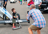 Sep 27, 2020; Gainesville, Florida, USA; A young fan poses for a photo in front of the dragster of NHRA top fuel driver Antron Brown during the Gatornationals at Gainesville Raceway. Mandatory Credit: Mark J. Rebilas-USA TODAY Sports