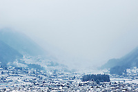 The edge of Matsumoto and the hills behind of a snowy winter's day, Nagano, Japan.