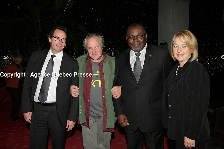 October 10, 2012 - Montreal. Quebec , Canada - Pierre-Karl Peladeau, CEO Quebecor (L) Claude Chamberland (M) and  Maka Kotto , Minister Cultural Affairs, Quebec (R)  at the <br /> Opening of Montreal New Cinema Festival (Festival du Nouveau Cinema de Montreal) at Place des arts  with LA MISE A L'AVEUGLE directed by Simon Galiero.<br /> It was his first speech as Minister.
