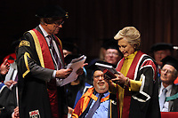 Pictured: Hillary Clinton on stage is being handed a commemorative book of her family tree at Swansea University Bay Campus. Saturday 14 October 2017<br />Re: Hillary Clinton, the former US secretary of state and 2016 American presidential candidate will be presented with an honorary doctorate during a ceremony at Swansea University's Bay Campus in Wales, UK, to recognise her commitment to promoting the rights of families and children around the world.<br />Mrs Clinton's great grandparents were from south Wales.