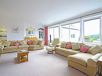 BNPS.co.uk (01202) 558833. <br /> Pic: LillicrapChilcott/BNPS<br /> <br /> Pictured: Living room. <br /> <br /> This impressive waterfront home with breath-taking views is the perfect property for a wannabe sailor - on the market for £2.5m.<br /> <br /> Huefield sits in an elevated position looking over the rooftops of neighbouring properties onto the beautiful Helford River in Cornwall - ideal for watching boats coming and going.<br /> <br /> The Helford Passage area is so sought after houses rarely come up for sale and this one, on the market with Lillicrap Chilcott, is the only property available there at the moment.<br /> <br /> The five-bedroom home is south facing and has a swimming pool and beautiful gardens for enjoying the view, as well as access to a gate with a right of way down to the water.
