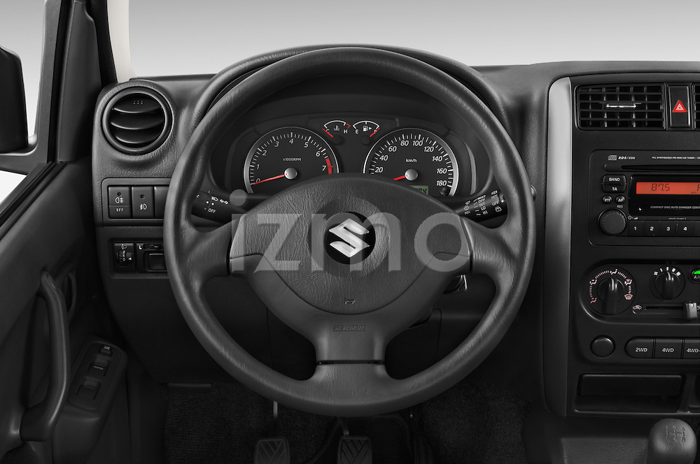 Car pictures of steering wheel view of a 2014 Suzuki JIMNY JLX X-Citement 3 Door SUV 4WD Steering Wheel