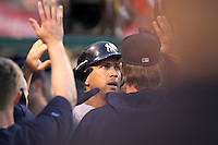 New York Yankees third baseman Alex Rodriguez #13 is greeted by teammates after hitting a home run against the Los Angeles Angels at Angel Stadium on June 4, 2011 in Anaheim,California. Larry Goren/Four Seam Images