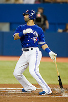 Toronto Blue Jays outfielder Jose Bautista #19 hits a three run home run in the first inning during an American League game against the Boston Red Sox at Rogers Centre on June 3, 2012 in Toronto, Ontario.  (Mike Janes/Four Seam Images)