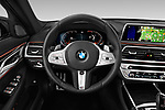 Car pictures of steering wheel view of a 2020 BMW 7 Series M Sport 4 Door Sedan