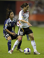 German midfielder (10) Renate Lingor keeps the ball away from Argentina forward (19) Analia Almeida. Germany (GER) defeated Argentina (ARG) 11-0 during an opening round Group A match of the FIFA Women's World Cup China 2007 at Shanghai Kongkou Football Stadium, Shanghai, China, on September 10, 2007.