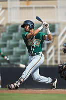 J.C. Millan (10) of the Greensboro Grasshoppers follows through on his swing against the Kannapolis Intimidators at Kannapolis Intimidators Stadium on August 13, 2017 in Kannapolis, North Carolina.  The Grasshoppers defeated the Intimidators 4-1 in 10 innings in the completion of a game suspended on August 12, 2017.  (Brian Westerholt/Four Seam Images)