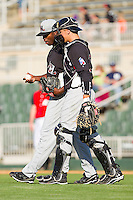 Catcher Kellin Deglan #15 of the Hickory Crawdads has a chat with pitcher Carlos Melo #31 during the game against the Kannapolis Intimidators at Fieldcrest Cannon Stadium on April 17, 2011 in Kannapolis, North Carolina.   Photo by Brian Westerholt / Four Seam Images