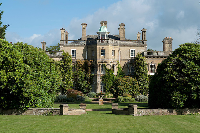 The core of Pylewell Park in Hampshire dates from the 17th century but has been added to over the years and the gardens here on the south front were laid out in the second half of the 19th century
