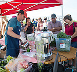 Vendor making juice at Farmer's Market