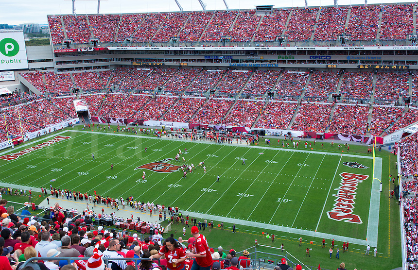 Professional NFL Football Tampa Bay Bucs and San Fransisco 49ers at Raymond James Stadium in Tampa Florida game with fans all in red on a winter day