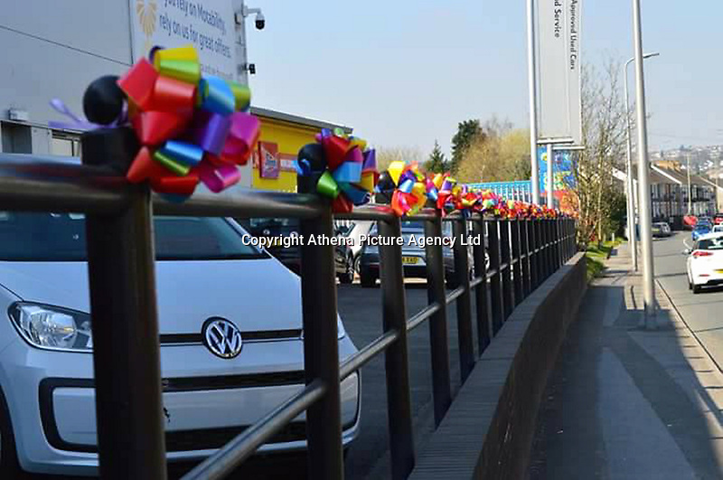 """COPY BY TOM BEDFORD<br /> Pictured: Rainbow ribbbons outside a garage in Merthyr Tydfil for Mia Chambers<br /> Re: One of Britain's poorest towns is raising £100,000 to send a little girl to America because the lifesaving drugs she needs are not available on the NHS.<br /> Brave Mia Chambers, five, is in remission after having an ovary and kidney removed due to neuroblastoma, a rare and aggressive type of cancer.<br /> Doctors have told her parents Josh and Kirsty there is a 50 per cent chance of the cancer returning without the specialist drugs.<br /> Josh, 28, said: """"That's not a chance we are prepared to take - the odds are too high.<br /> """"We researched it on the internet and found children in the US are beating this terrible illness.<br /> """"Doctors there are willing to treat her but it will cost more money than we have.""""<br /> The couple's plight has touched the hearts of people in their home town of Merthyr Tydfil, South Wales, and money has begun pouring in.         <br /> Mia had chemotherapy on the Rainbow ward at the Noah's Ark Children's Hospital for Wales where nurses nicknamed her the Rainbow Warrior because of her fighting spirit."""