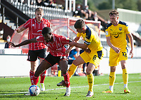 Lincoln City's Timothy Eyoma battles with Oxford United's Cameron Brannagan<br /> <br /> Photographer Andrew Vaughan/CameraSport<br /> <br /> The EFL Sky Bet League One - Saturday 12th September  2020 - Lincoln City v Oxford United - LNER Stadium - Lincoln<br /> <br /> World Copyright © 2020 CameraSport. All rights reserved. 43 Linden Ave. Countesthorpe. Leicester. England. LE8 5PG - Tel: +44 (0) 116 277 4147 - admin@camerasport.com - www.camerasport.com - Lincoln City v Oxford United