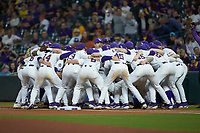 The LSU Tigers huddle up prior to the game against the Texas Longhorns in game three of the 2020 Shriners Hospitals for Children College Classic at Minute Maid Park on February 28, 2020 in Houston, Texas. The Tigers defeated the Longhorns 4-3. (Brian Westerholt/Four Seam Images)