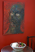 red wall with modern painting