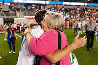 United States (USA) forward Abby Wambach (20) hugs her mother Judy Wambach after the match. The women's national team of the United States defeated the Korea Republic 5-0 during an international friendly at Red Bull Arena in Harrison, NJ, on June 20, 2013.