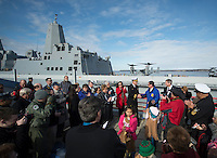 130501-N-DR144-637 COOK INLET, Alaska (May 1, 2013)- Commanding Officer Cmdr. Joel Stewart shakes hands with Mayor of Anchorage Dan Sullivan during a welcoming ceremony for San Antonio-class amphibious transport dock ship USS Anchorage (LPD 23) at the Port of Anchorage. Anchorage arrived at its namesake city of Anchorage, Alaska for its commissioning ceremony scheduled to take place May 4. (U.S. Navy photo by Mass Communication Specialist 1st Class James R. Evans / RELEASED)