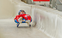 5 December 2014: Dominik Fischnaller, sliding for Italy, crosses the finish line on his first run, ending the day with a 3rd place finish and a combined 2-run time of 1:43.181 in the Men's Competition at the Viessmann Luge World Cup, at the Olympic Sports Track in Lake Placid, New York, USA. Mandatory Credit: Ed Wolfstein Photo *** RAW (NEF) Image File Available ***