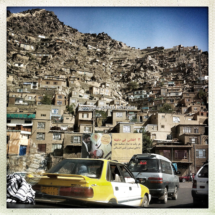 ** TO GO WITH AFGHANISTAN STORY FOR PETER MURTAGH - NO ARCHIVE, NO RESALE ** Unplanned housing on the hillsides in Kabul, 21 August 2012. (John D McHugh)