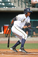 Charleston Riverdogs infielder Jimmy Paredes #13 batting during a game vs. the Rome Braves at Joseph P. Riley Jr. Ballpark in Charleston, South Carolina on June 6, 2010. Charleston defeated Rome by the score of 4-2.  Photo By Robert Gurganus/Four Seam Images