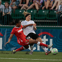 Kandace Wilson (8) of the Western New York Flash attempts a tackle on Ella Masar (55) of the magicJack in the second half. The Western New York Flash defeated the magicJack 3-0 in Women's Professional Soccer (WPS) at Sahlen's Stadium in Rochester, NY May 22, 2011.