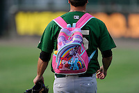 """Pitcher John Mincone (25) of the Savannah Sand Gnats carries snacks to the bullpen in a pink """"My Little Pony"""" backpack before a game against the Greenville Drive on Friday, August 22, 2014, at Fluor Field at the West End in Greenville, South Carolina. Greenville won, 6-5. (Tom Priddy/Four Seam Images)"""