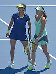 Martina Hingis (SUI) (green dress) joins Sania Mirza (IND) in doubles to defeat Christina McHale (USA) and CoCo Vandeweghe 6-4, 6-1at the Western and Southern Open in Mason, OH on August 21, 2015.