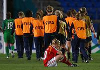USA celebrate their win as dejected Germany player Leonie Maier shows her despair..FIFA U17 Women's World Cup, Semi Final, Germany v USA, QEII Stadium, Christchurch, New Zealand, Thursday 13 November 2008. Photo: Renee McKay/PHOTOSPORT