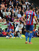 Pictured L-R: Jason Puncheon of Crystal Palace against Jack Cork of Swansea<br />