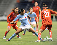 # 11 Cristiane of the Chicago Red Stars tries to get control the the ball from  #21 Alex Singer of the Washington Freedom. The Red Stars won the game 2-1