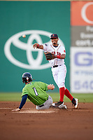 Salem Red Sox shortstop Santiago Espinal (5) turns a double play during a game against the Lynchburg Hillcats on May 10, 2018 at Haley Toyota Field in Salem, Virginia.  Lynchburg defeated Salem 11-5.  (Mike Janes/Four Seam Images)