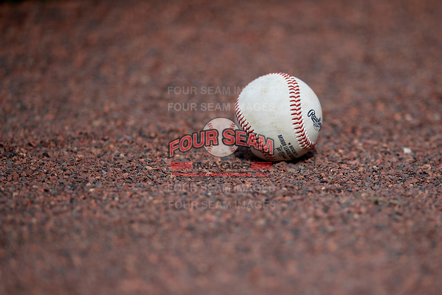 Minor League Baseball made by Rawlings sits in the warning track dirt during a Florida Instructional League game between the Pittsburgh Pirates and Detroit Tigers on October 16, 2020 at Joker Marchant Stadium in Lakeland, Florida.  (Mike Janes/Four Seam Images)