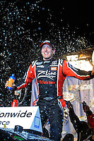 Feb 21, 2009; Fontana, CA, USA; NASCAR Nationwide Series driver Kyle Busch celebrates after winning the Stater Brothers 300 at Auto Club Speedway. Mandatory Credit: Mark J. Rebilas-