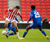 9th January 2021; Bet365 Stadium, Stoke, Staffordshire, England; English FA Cup Football, Carabao Cup, Stoke City versus Leicester City; Jacob Brown of Stoke City is tackled as Ndidi of Leicester covers the play