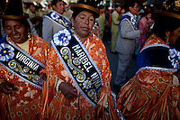 .Aymara women  dacing during the parade to celebrate the day of El Alto.Just 25 years ago it was a small group of houses around La Paz  airport, at an altitude of 12,000 feet. Now El Alto city  has  nearly one million people, surpassing even the capital of Bolivia, and it is the city of Latin America that grew faster .<br /> It is also a paradigmatic city of the tubles and traumas of the country. There got refugee thousands of miners that lost  their jobs in 90 ´s after the privatization and closure of many mines. The peasants expelled by the lack of land or low prices for their production. Also many who did not want to live in regions where coca  growers and the Army  faced with violence.<br /> In short, anyone who did not have anything at all and was looking for a place to survive ended up in El Alto.<br /> Today is an amazing city. Not only for its size. Also by showing how its inhabitants,the poorest of the poor in one of the poorest countries in Latin America, managed to get into society, to get some economic development, to replace their firs  cardboard houses with  new ones made with bricks ,  to trace its streets,  to raise their clubs, churches and schools for their children.