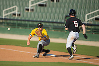 West Virginia Power first baseman Jerrick Suiter (25) stretches for a throw as Toby Thomas (5) of the Kannapolis Intimidators hustles down the line at CMC-Northeast Stadium on April 21, 2015 in Kannapolis, North Carolina.  The Power defeated the Intimidators 5-3 in game one of a double-header.  (Brian Westerholt/Four Seam Images)