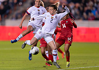 Emily Sonnett #2 of the United States tries to redirect a corner