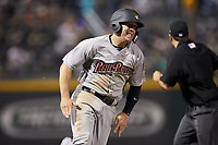 Billy Fleming (20) of the Scranton/Wilkes-Barre RailRiders hustles towards home plate against the Charlotte Knights at BB&T BallPark on April 12, 2018 in Charlotte, North Carolina.  The RailRiders defeated the Knights 11-1.  (Brian Westerholt/Four Seam Images)