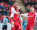 Stirling's Phil Johnston (left) celebrates after he scores their fourth goal.